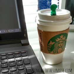 starbucks cup with laptop